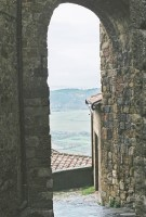 Tuscan view from one of Montepulciano's many arches